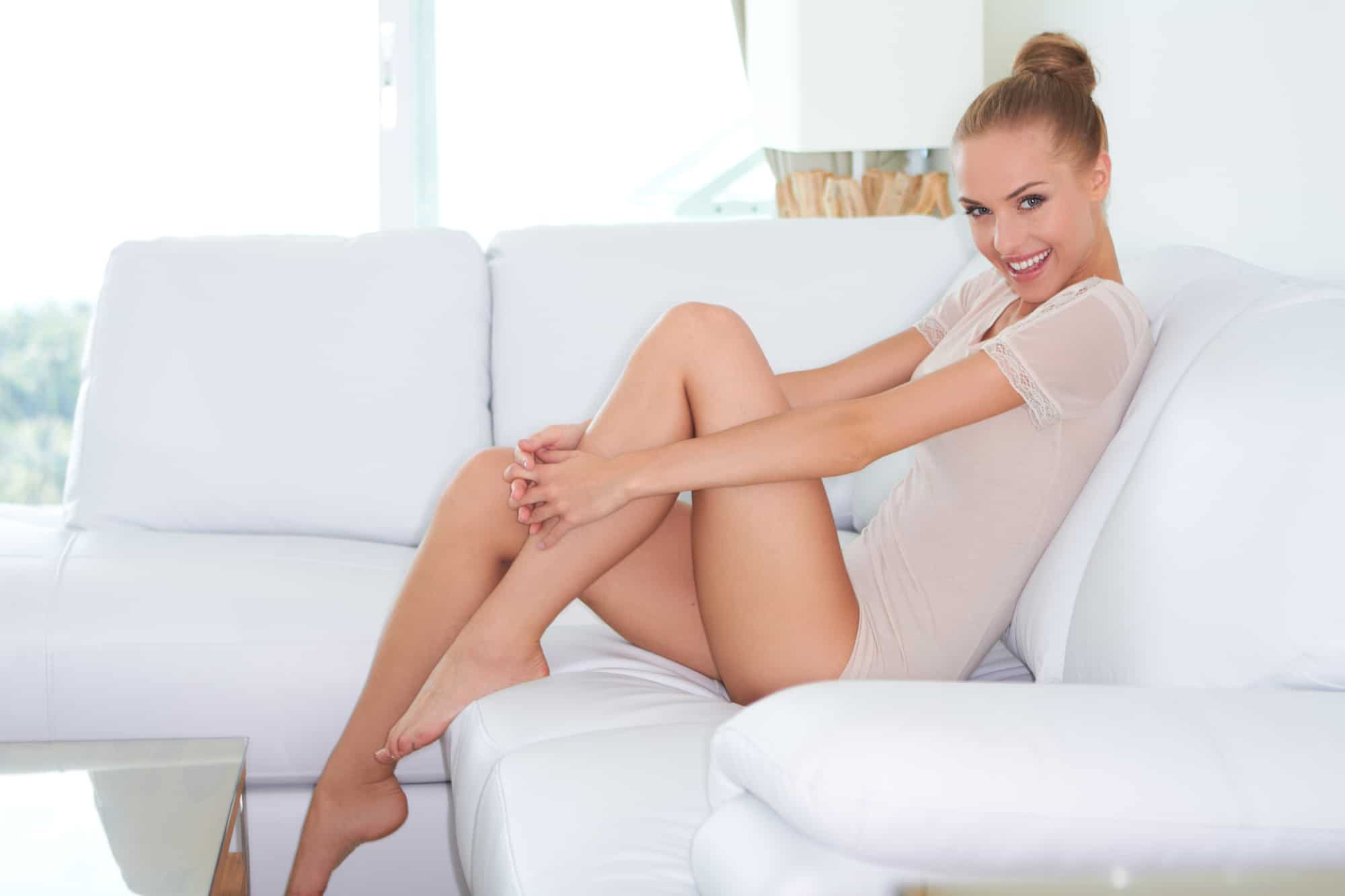 Smiling woman on white couch