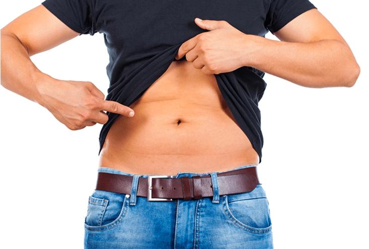 man pointing to abdomen